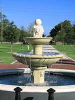 Stately water fountain in circular pool