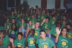 Large group in summer camp shirts