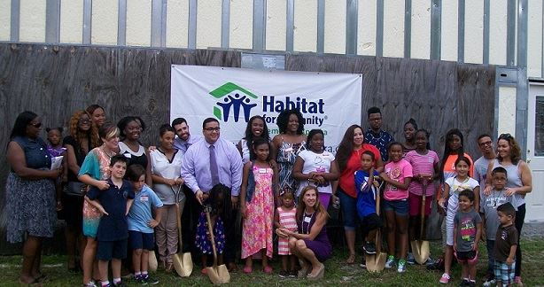 Group standing for opening of Habitat for Humanity