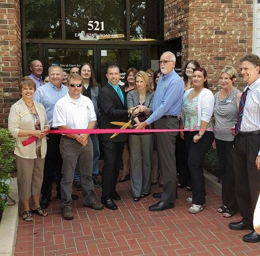 Group standing and ready to cut ribbon for Precision Tax and Accounting, Inc.